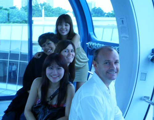 With colleagues on the Singapore Flyer